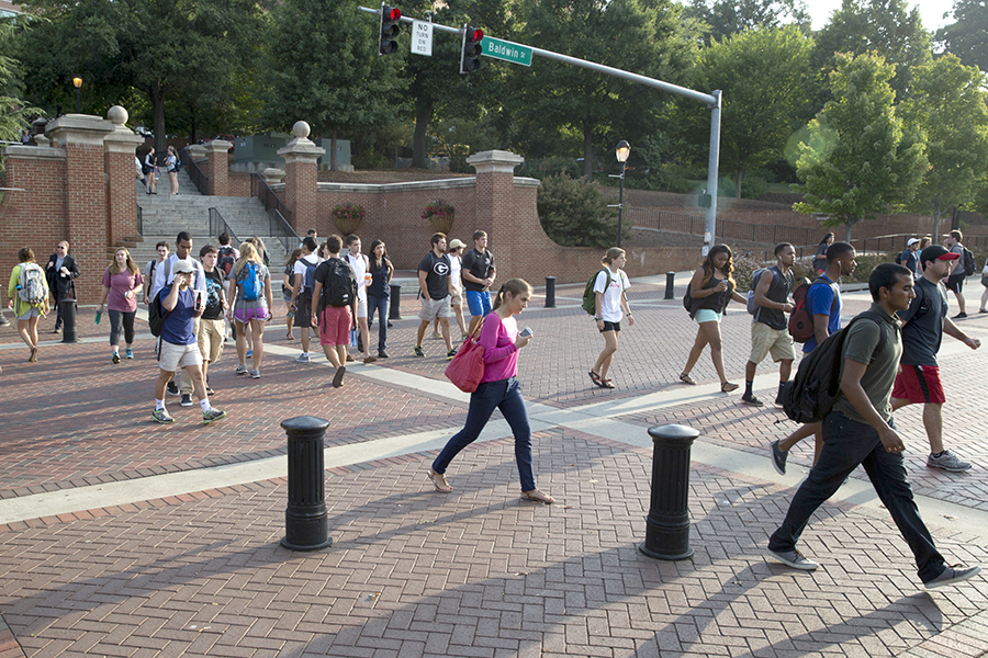 Photo of the Baldwin crosswalk with a crowd of students crossing the street.